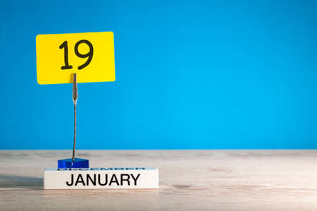 January 19th. Day 19 of january month, calendar on blue background. Winter time. Empty space for text, mock up