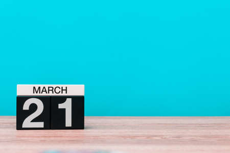 March 21st. Day 21 of month, calendar on table with turquoise background. Spring time, empty space for text Stock Photo
