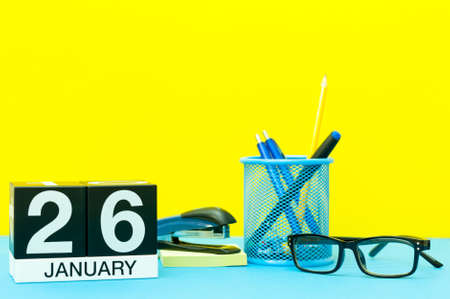 January 26th. Day 26 of january month, calendar on yellow background with office supplies. Winter time