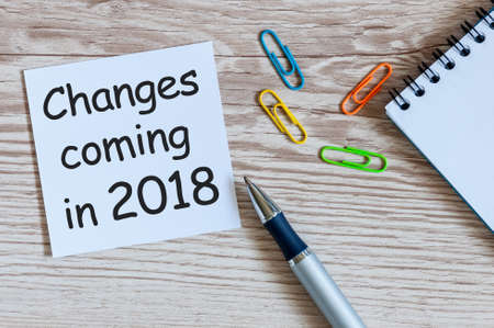 A note Changes coming in 2018. With office or school supplies. Foto de archivo