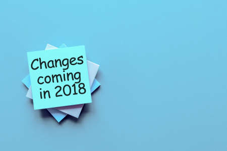 Change is coming in 2018. text write on pile of paper.