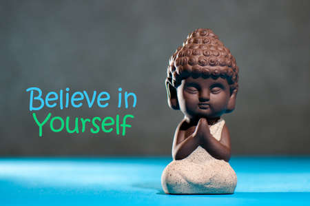 Believe In Yourself Confident Encourage Motivation Concept with meditating or praying baby buddha