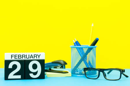 February 29th. Day 29 of february month, calendar on yellow background with office supplies. Winter time, Leap-year