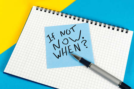 If Not Now When - question in note at workplace. Goals Ambition Concept Stock Photo
