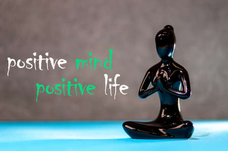 Positive mind - positive life. figurine of a meditating young girl. Lifestyle Positive Thoughts Mind Life Concept