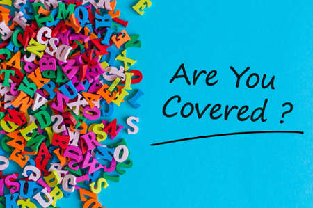 Many little alphabets letters and inscription - Are you covered. Insurance concept Stock Photo