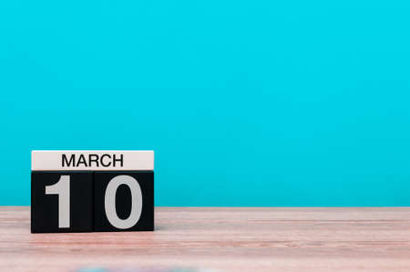 March 10th. Day 10 of march month, calendar on turquoise background. Spring time, empty space for text, mockup Stockfoto