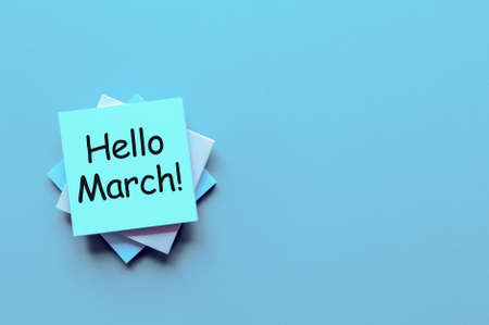 Hello March - message at workplace with empty space for text, mockup or template. 1st. day of march - 1 spring month