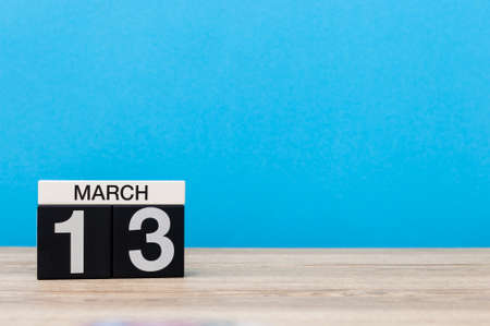 March 13th. Day 13 of march month, calendar on light blue background. Spring time, empty space for text, mockup