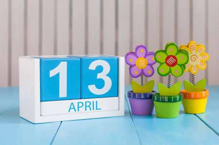 April 13th. Image of april 13 wooden color calendar on white background with flowers. Spring day, empty space for text. World Rock-n-roll Day Standard-Bild