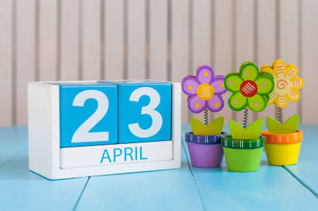 April 23rd. World Book Day. Image of april 23 wooden color calendar on white background with flowers. Spring day, empty space for text