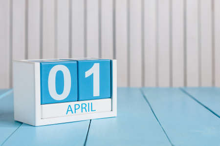April 1st. Image of april 1 wooden color calendar on white background.  Spring day, empty space for text. All Fools Day