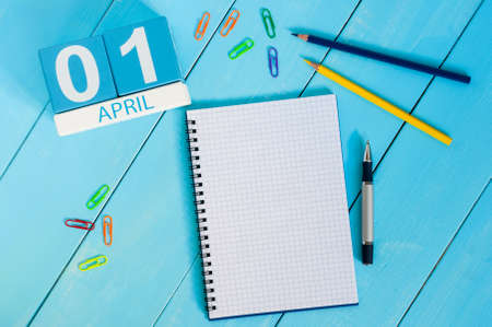 April 1st. Image of april 1 wooden color calendar on blue background. Spring day, empty space for text. All Fools Day