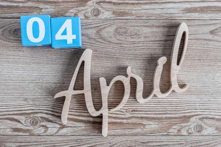 April 4th. Day 4 of april month, color calendar on wooden background. Spring time