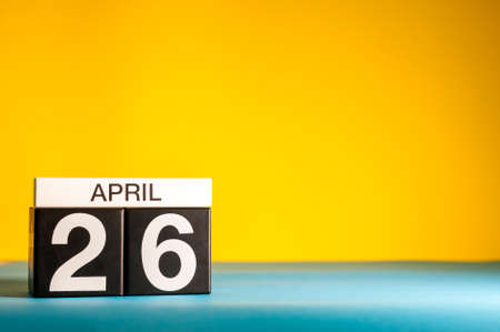 April 26th. Day 26 of april month, calendar on table with yellow background. Spring time, empty space for text 스톡 콘텐츠