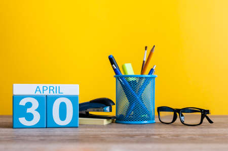 April 30th. Day 30 of month, calendar on business office background, workplace. Spring time Stock Photo