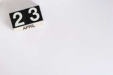 April 23rd. World Book Day. Image of april 23 wooden color calendar on white background.  Spring day, empty space for text