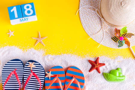 May 18th. Image of may 18 calendar with summer beach accessories. Spring like Summer vacation concept