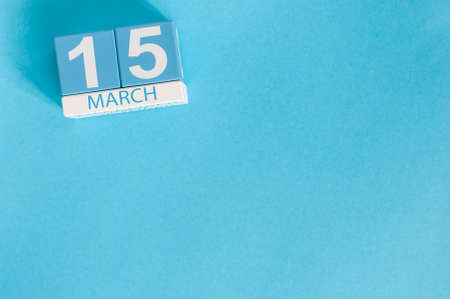 March 15th. Image of march 15 wooden color calendar on blue background.  Spring day, empty space for text. World Consumer Rights Day Stock Photo