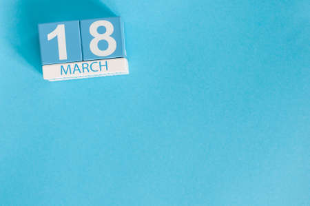March 18th. Image of march 18 wooden color calendar on blue background. Spring day, empty space for text. World Sleep Day