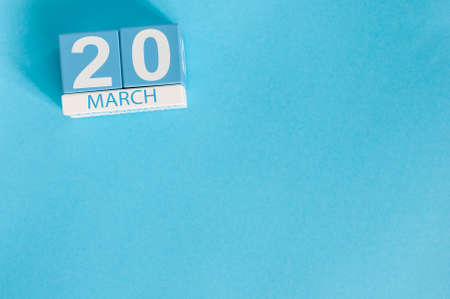 March 4th. Image of march 4 wooden color calendar on blue background.  Spring day, empty space for text. Vernal Equinox, Earth Day
