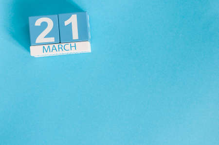 March 21st. Image of march 21 wooden color calendar on blue background.  Spring day, empty space for text. World Down Syndrome Day, International DAy Of Forests