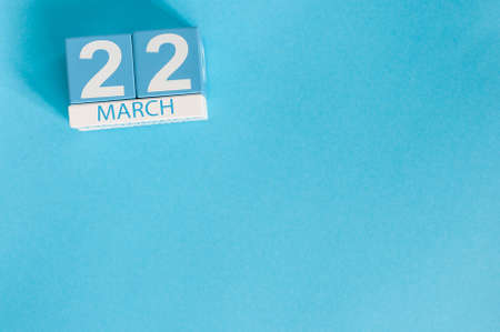 March 22nd. Image of march 22 wooden color calendar on blue background.  Spring day, empty space for text. World Day Of taxi service Stock Photo