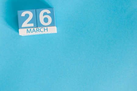 March 26th. Image of march 26 wooden color calendar on blue background.  Spring day, empty space for text. Purple DAy is the international day For epilepsy awareness.