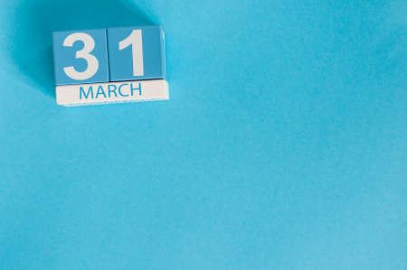 March 31st. Image of march 31 wooden color calendar on blue background.  Spring day, empty space for text. World Backup Day and the month end