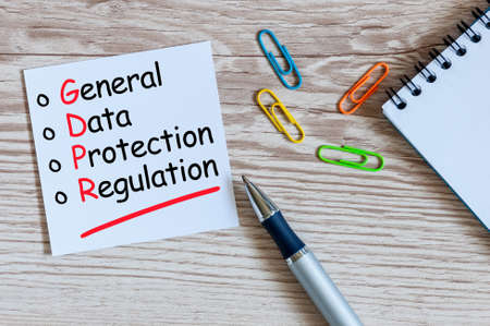 GDPR or General Data Protection Regulation. A note at office workplace background Фото со стока