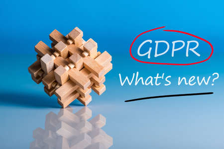 General Data Protection Regulation or GDPR Compliance - What is new. Question on blue background with wooden brain teaser Standard-Bild - 101982166