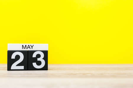 May 23rd. Day 23 of may month, calendar on yellow background. Spring time, empty space for text Stock Photo