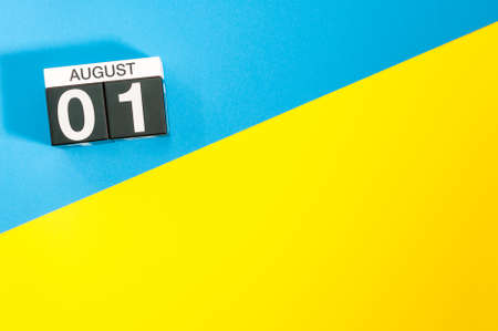 August 1st. Day of the month 1, calendar on blue and yellow background. Summer time. Empty space for text 스톡 콘텐츠