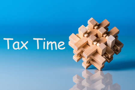 tax time, reminder with wooden brain teaser