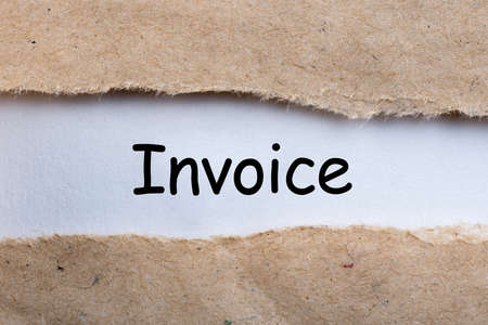 Invoice in torn brown envelope. Business concept