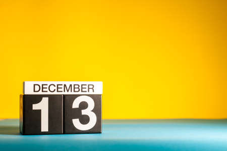 December 13th. Image 13 day of december month, calendar on yellow background with empty space for text Imagens