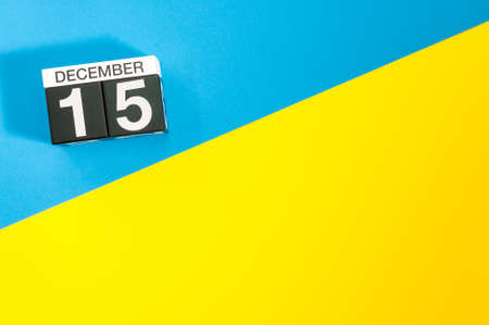 December 15th. Image 15 day of december month, calendar on blue-yellow background with empty space for text, mockup