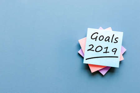 2019 goals on blue background. Goal, dreams and New Year's promises for the next year. Banco de Imagens