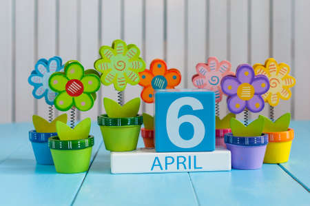 April 6th. Image of april 6 wooden color calendar on white background with flowers. Spring day, empty space for text Standard-Bild - 121046894