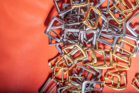 A lot of Belt buckles and coral leather background Standard-Bild - 121046921