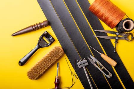 Leather crafting tools still life. Handmade accessories Standard-Bild - 121046930
