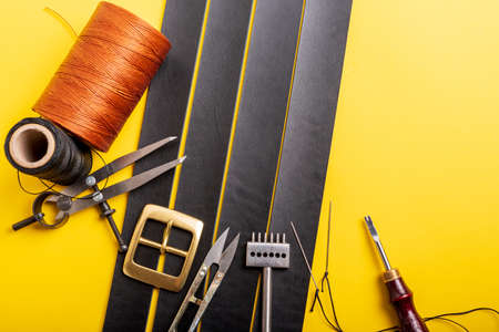Leather crafting tools still life. Handmade accessories Standard-Bild - 121046933