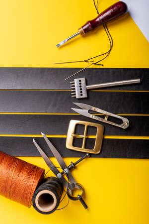 Leather crafting tools still life. Handmade accessories Standard-Bild - 121046936