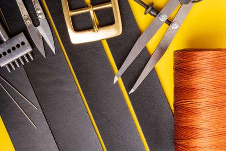Leather crafting tools still life. Handmade accessories Standard-Bild - 121047224