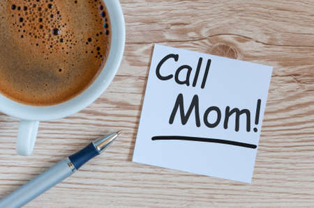 Call Mom - A message asking or reminding you to call your mom. Parenting Concept 写真素材