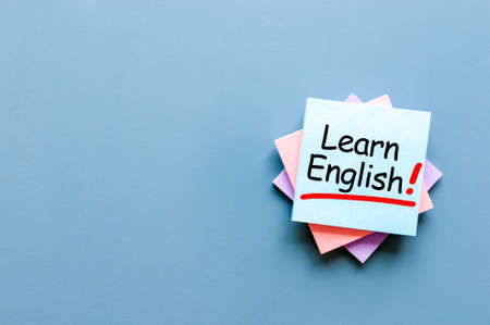 Learn english - note at blue background with empty space for text
