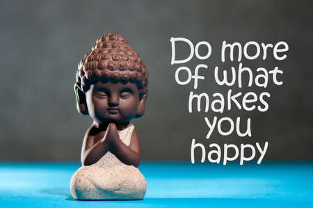 Do more of what makes you happy - inspirational background with white statuette of Buddha. Yoga and meditation concept