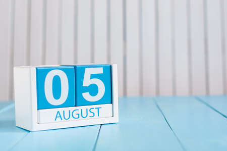August 5th. Image of august 5 wooden color calendar on blue background. Summer day. Empty space for text. International Beer Day