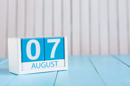 August 7th. Image of august 7 wooden color calendar on blue background. Summer day. Empty space for text