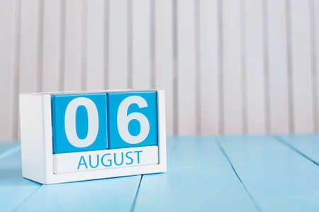 August 6th. Image of august 6 wooden color calendar on blue background. Summer day. Empty space for text 写真素材
